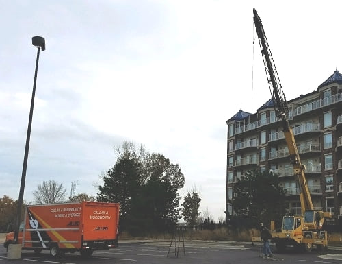 Callan and Woodworth Moving Into Condo With Crane
